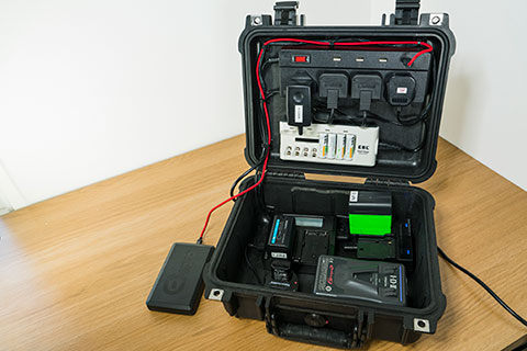 Charging case for camera batteries